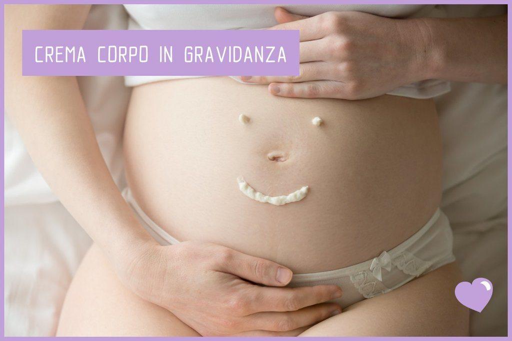 Crema corpo su pancia in gravidanza